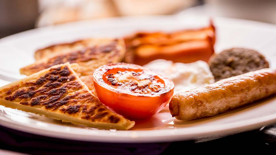 Fly to Belfast, try an Ulster Fry for breakfast.
