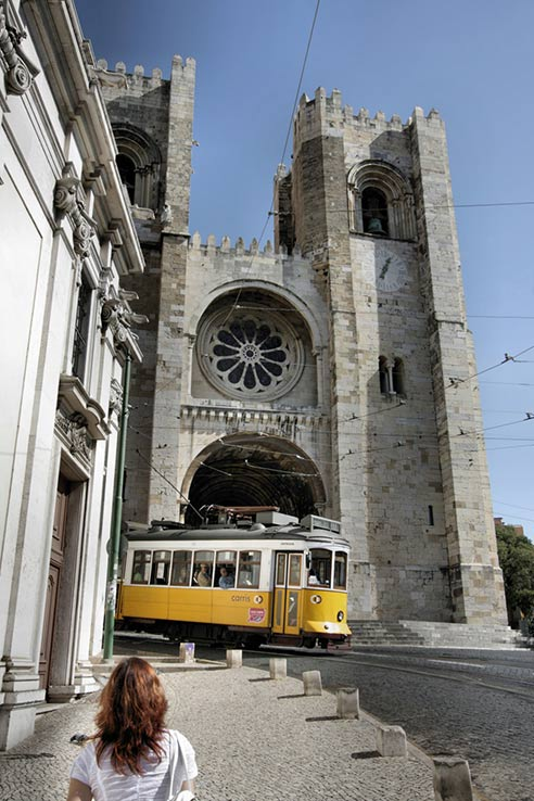 Fly to Lisbon, ride on one of the city's old trams.